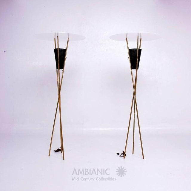 For your consideration a pair of Mid-Century Modern floor lamps or torchierers. Tripod base in brass with perforated metal...