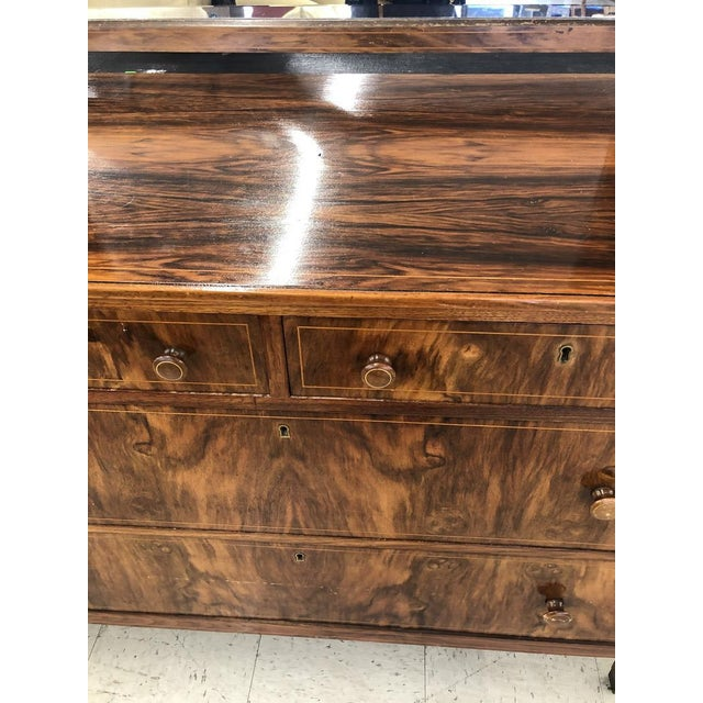 Antique flamed mahogany solid wood dresser with dovetailed solid wood drawers. Drawers slide smoothly and the dresser is...