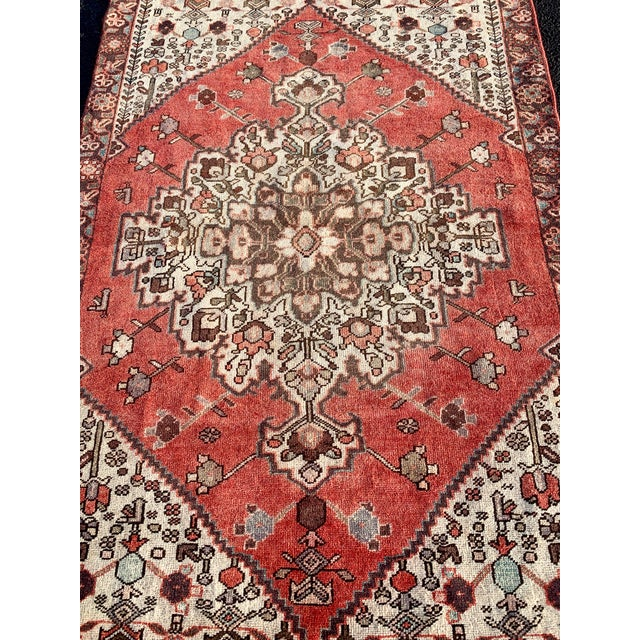 This is a vintage Persian Hamadan rug. The piece was made in the 1960s.