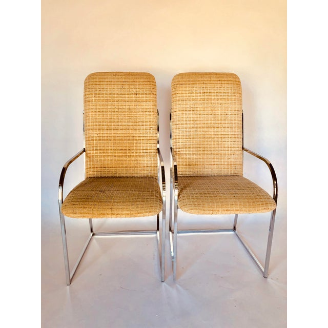 This is a set of two or four Mid-Century high back dining armchairs with chrome frames by Design Institute of America. The...