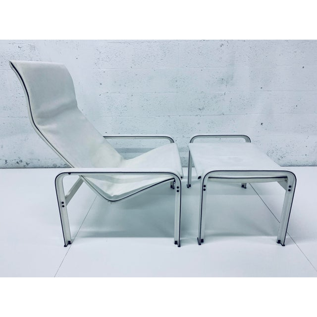 Original saddle-stitched, distressed white leather lounge chair and ottoman on aluminum frame by Matteo Grassi. Maintains...