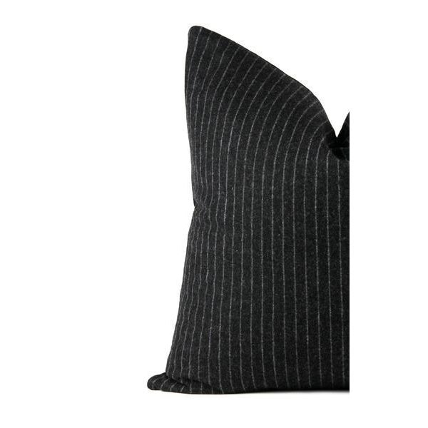 Professionally crafted large lumbar pillow featuring a charcoal gray wool with a pale gray pin stripe. Modern and...