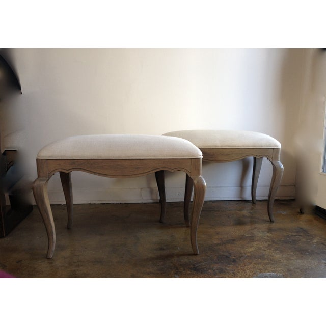 A fresh take on vintage French Provincial style benches in solid oak. We have updated them with a tan-gray wash finish and...