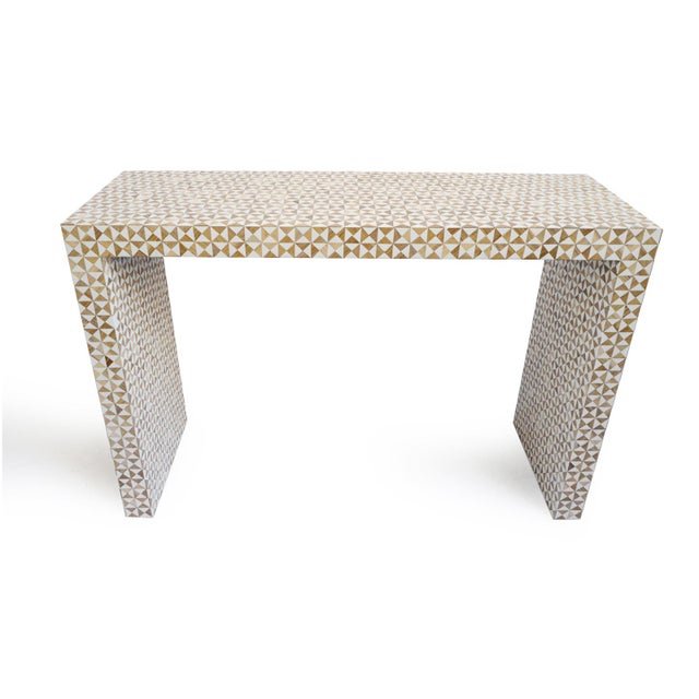 Beautiful geometric inlay modern console table. Hand carved wood alternating with bone triangle and square design pattern....