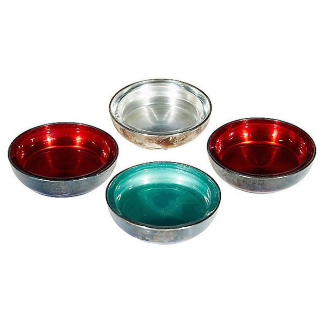 Set of four multicolored round metal coasters. Marked: Rogers.