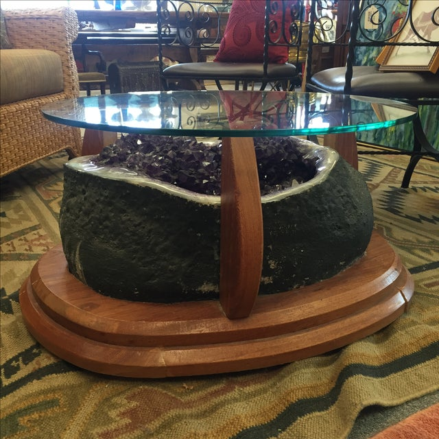 Stunning large Amethyst crystal geode mounted as a coffee table. Geode set in wooden framework with glass resting on the...