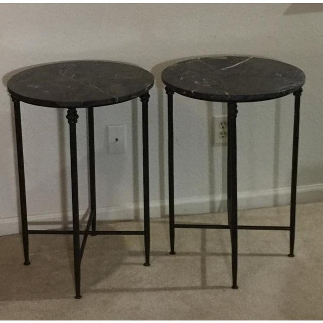Mid century sharp and black on black metal marble side round tables. Nice accent tables with black metal legs with black...