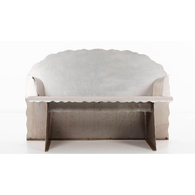 Important hand-produced aluminum prototype was created to determine if the form, comfort and structure of the bench was...