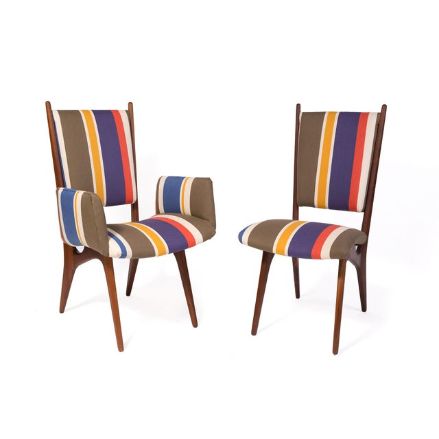 Vladimir Kagan studio dining chairs from 1957. These rare examples have sculpted solid walnut frames and have been newly...