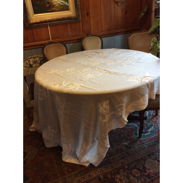 This is an exquisite dining table set of appliquéd table cloth measuring 108 x 70, and 12 matching napkins.
