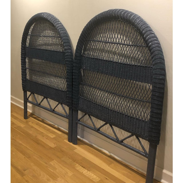These vintage wicker headboards (twin size) have been painted a glossy deep, almost navy, blue. They are tall and nicely...