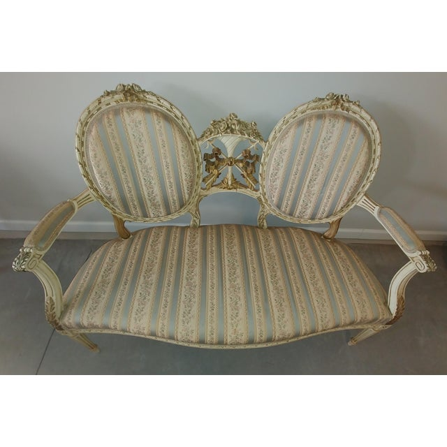 A longtime lover of antiques, I discovered this beautiful Louis XVI settee from the early 1800s in a musty old antique...