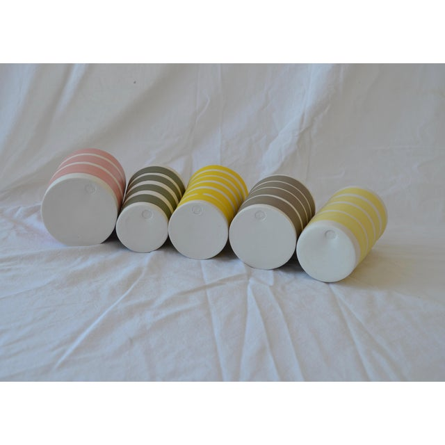 This is a set of 5 cylindrical vessels are glazed with yummy candy colored matte satin stripes on the bare vitrified...