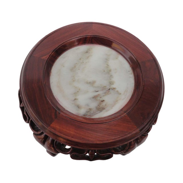 This elegant round display stand is made of Hua Li rosewood and has natural marble on the top. The carving is unique and...