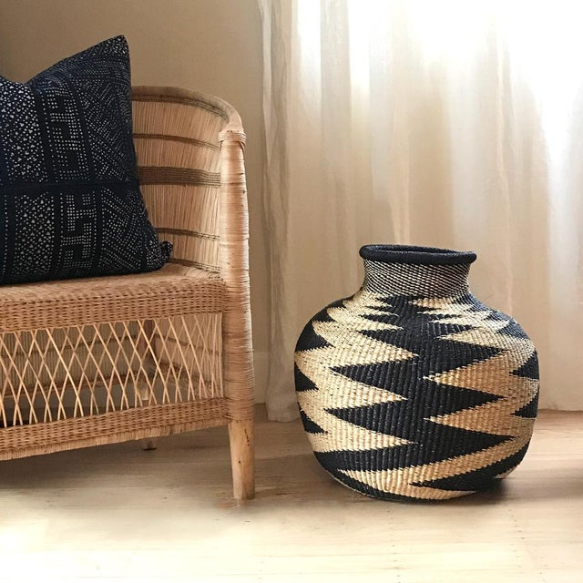 We love the organic shape and textural elements of this handwoven basket from Ghana. A stunning piece to add a touch of...