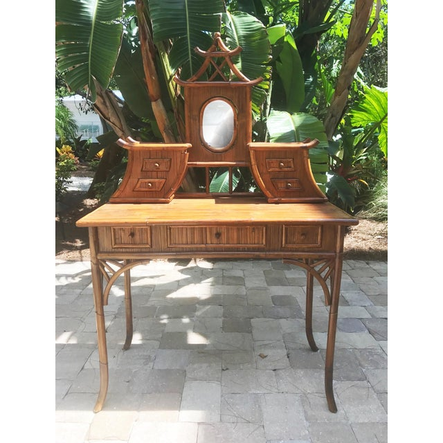 This vintage bamboo vanity is Pagoda Perfect! Gorgeous detailing, tons of storage, and an amazing statement piece for any...