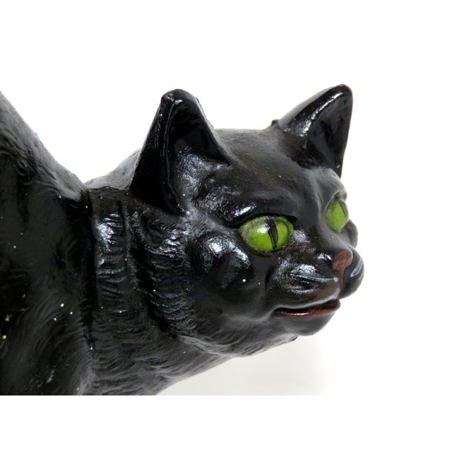 Cast iron startled black Halloween cat doorstop with original hand painted features. Made by the Hubley Foundry USA, circa...