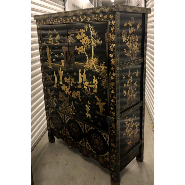 Vintage Chinese Black Lacquer Chinoiserie Cabinet. It is of superb quality and features beautiful scenic hand painted...