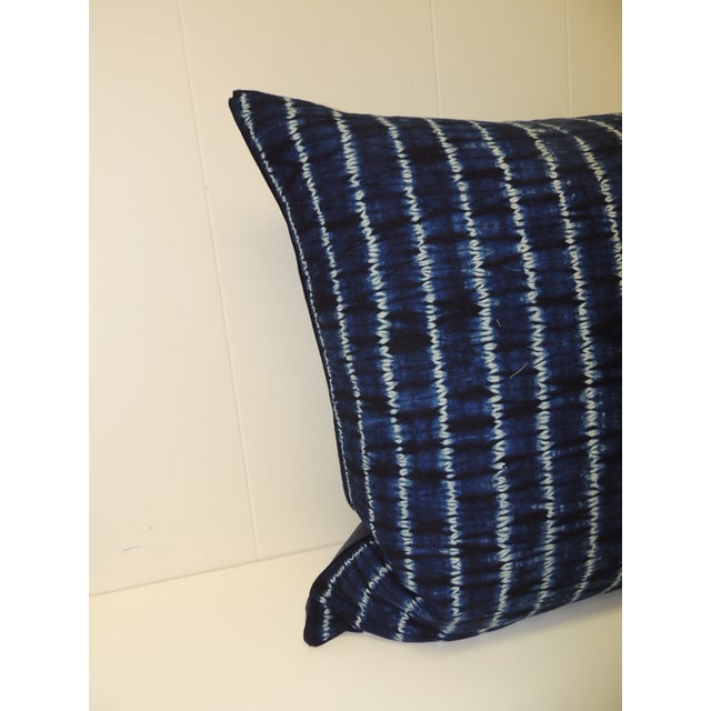 Vintage indigo and white African resist-dye textile decorative pillow Square pillow with textured navy blue backing and...