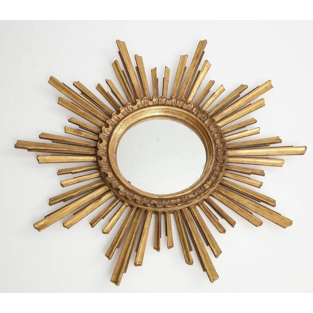 This is a particularly attractive sunburst mirror, with its beautiful patina, variegated rays and double molded centre...