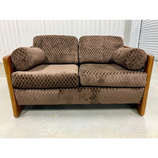 Mid century modern cane sided loveseat. Newly reupholstered in velvet diamond upholstery. Very unique and stylish sofa...