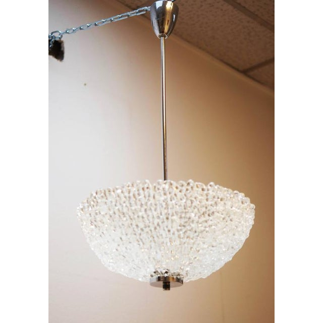 This ice glass optic ceiling light in the shape of a hemisphere was made by Austrolux in Vienna in the 1960s, and is...