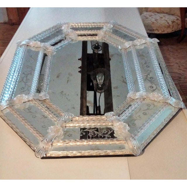 This stunning large vintage Venetian mirror features etched glass flowers and rope edging. A beautiful addition to any room.