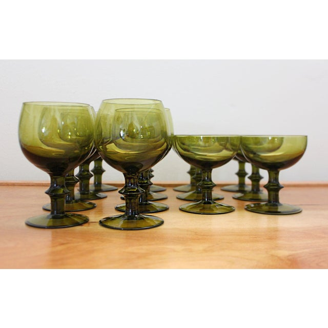 In the style of Carlo Moretti glass, these glasses have an elegant shape and classic color. This set has six champagne...