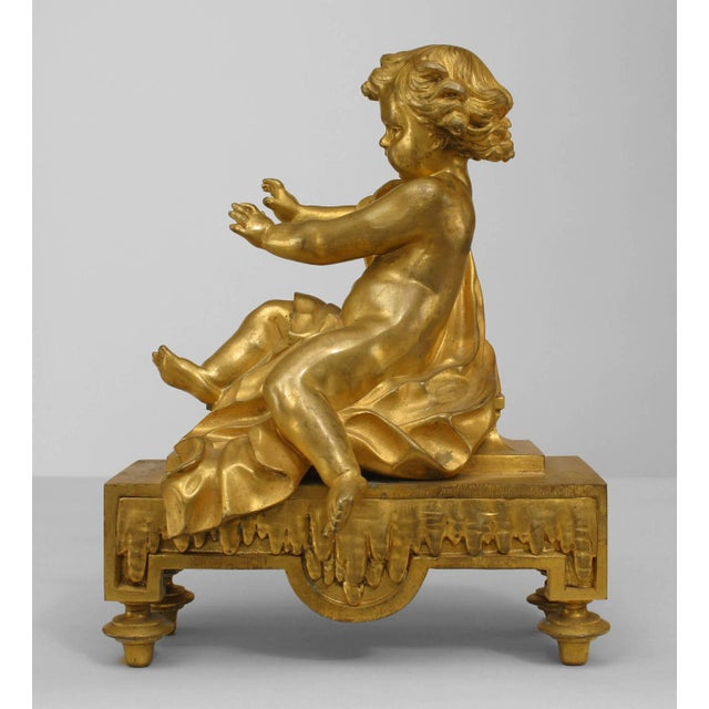 Pair of nineteenth century French gilt bronze draped draped putti figural andirons (chenets) on architectural bases.
