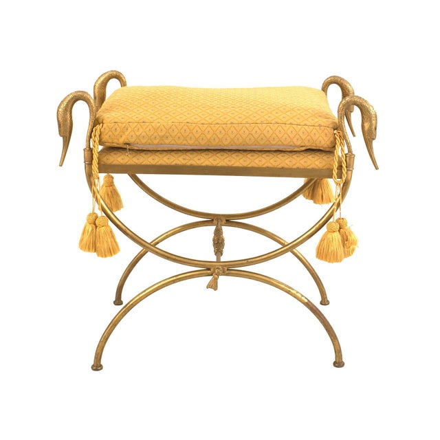 French 1940s Directoire style, gilt bronze cross leg bench with swan head form arms (stamped: JANSEN). Maison Jansen was a...