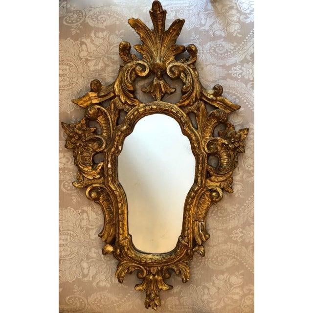 Italian Cornucopia Bois Doré Wall Mirror, C. 1890-1930. Classical Style Carved Gilt Wood with nice patina.