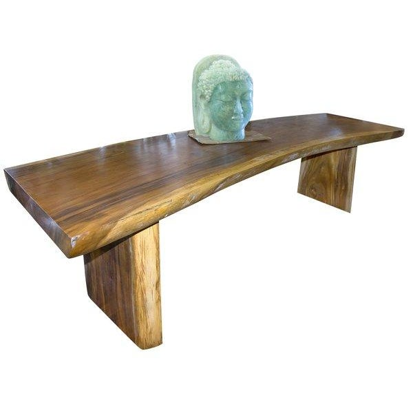 This One of a kind wood dining table is unique and elegant. It would make a statement piece in any house.