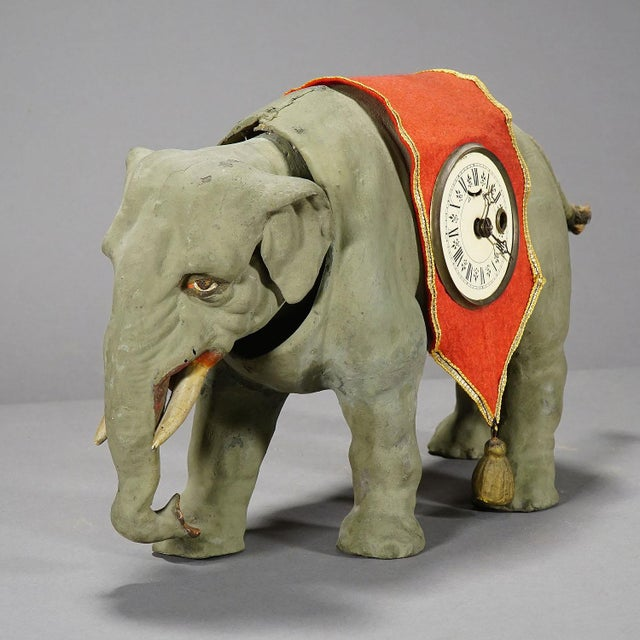 a rare clock in the shape of an elephant. a handpainted papier marche case with mechanical clockwork. the tail and the...
