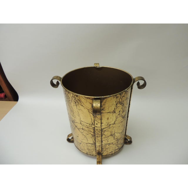 Metal gold leaf vintage waste basket/garbage can with turned iron details. Size: 10 x 12 x 14 H