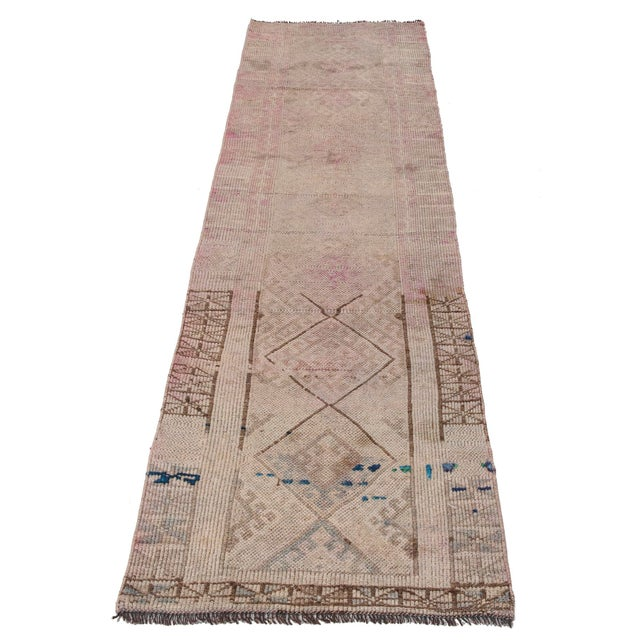 Decorative vintage hand-knotted runner rug from South Eastern Turkey. Approximately 50-60 years old. In very good condition.
