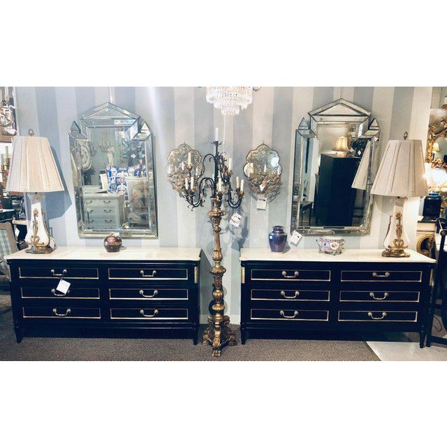 Pair of Maison Jansen style ebony marble-top dressers commodes chest of drawers. Each in the Louis XVI style with ebony...