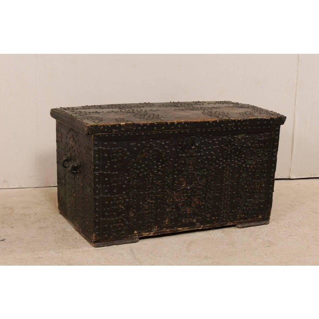 A Spanish Baroque studded coffer from the turn of the 18th and 19th centuries. This antique Spanish coffer, with it's...
