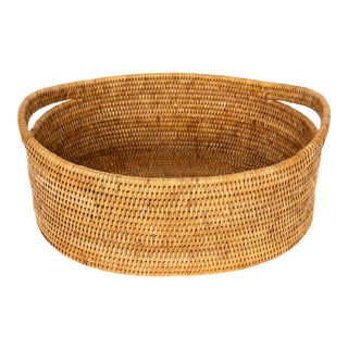 Artifacts Rattan Oval Basket With Cutout Handles in Honey Brown For Sale