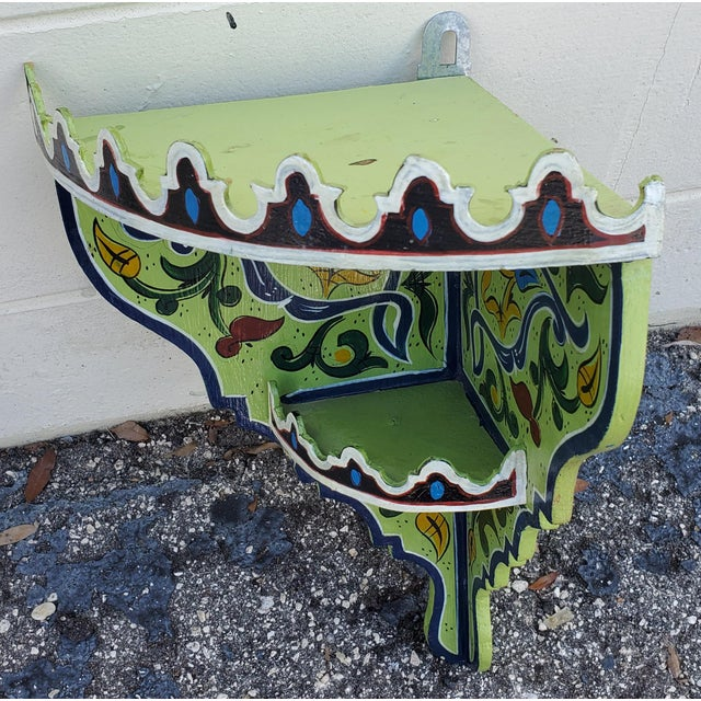 Amazingly handcrafted and hand painted reclaimed wood corner shelf from Morocco. Triangle shape. Green is the color. Would...