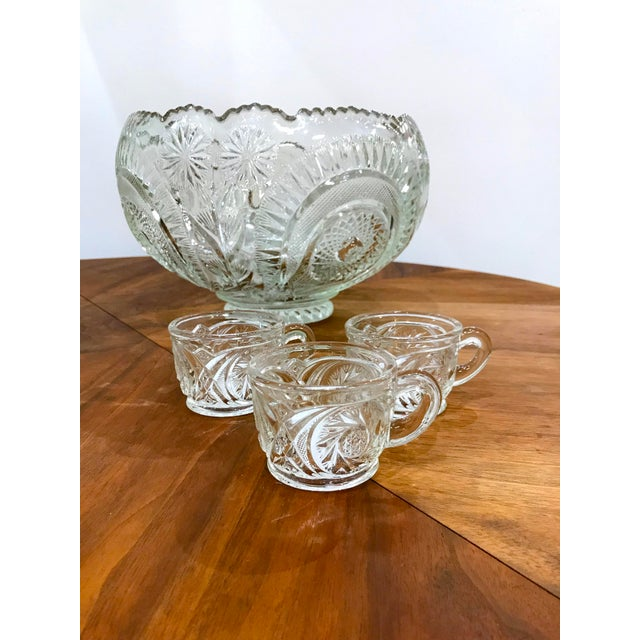Beautiful glass punch bowl set with ten (10) cups for your holiday gatherings. A lovely swirl and flower pattern. Bowl:...