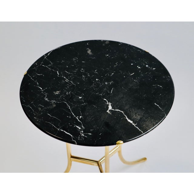 Side table designed by Cedric Hartman, signed and numbered. Brass frame with black marble top.