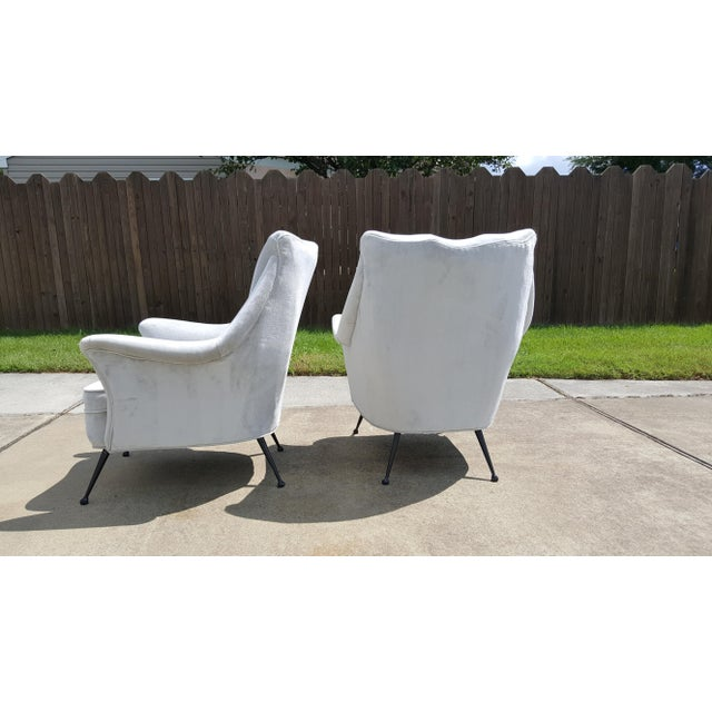 This stunning, sculptural pair of lounge chairs were made in Italy circa 1950. They have been recently reupholstered in a...