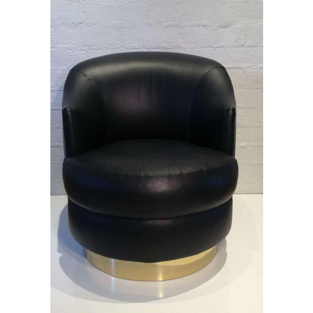 Black leather swivel chair designed by Karl Springer. Smooth soft rich black leather all original . Wood base with a brass...