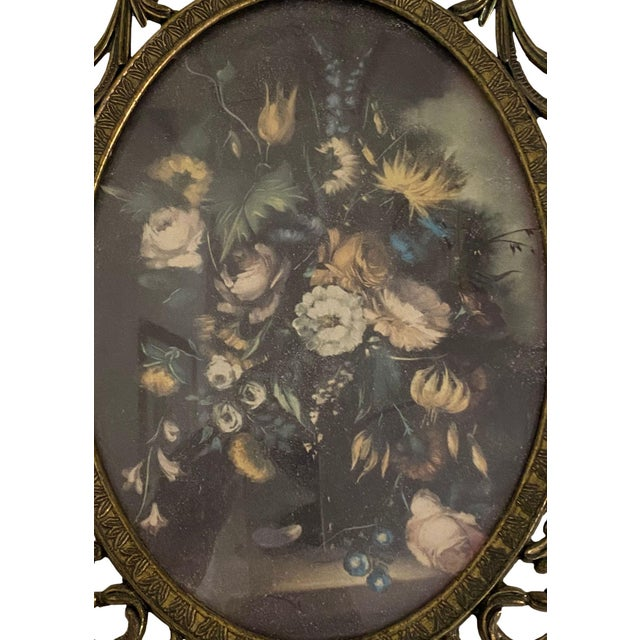 A Italian floral print in an ornate metal frame with convex glass.