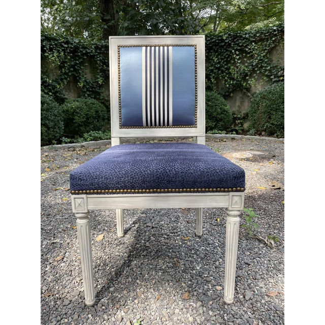This is a lovely set of seven white painted dining chairs by Bernhardt. Each chair has a rectangular padded back and...