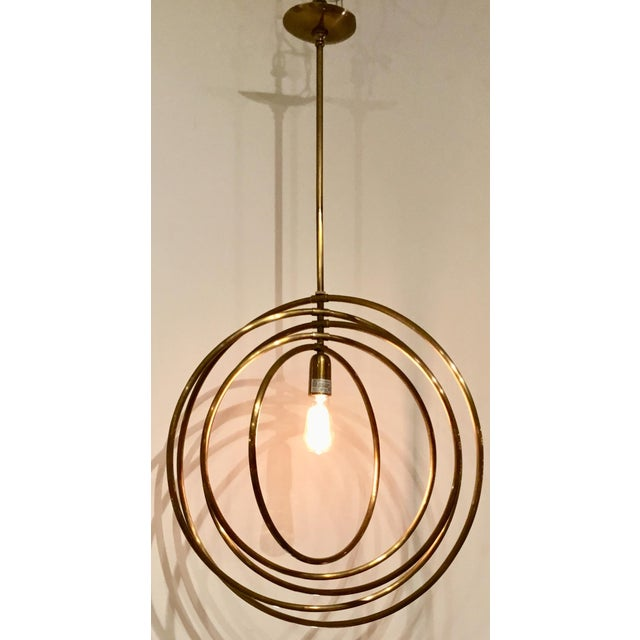 Stylish modern Arteriors Quintana Antique Brass Chandelier, five rings, beautiful and versatile with an Edison bulb,...