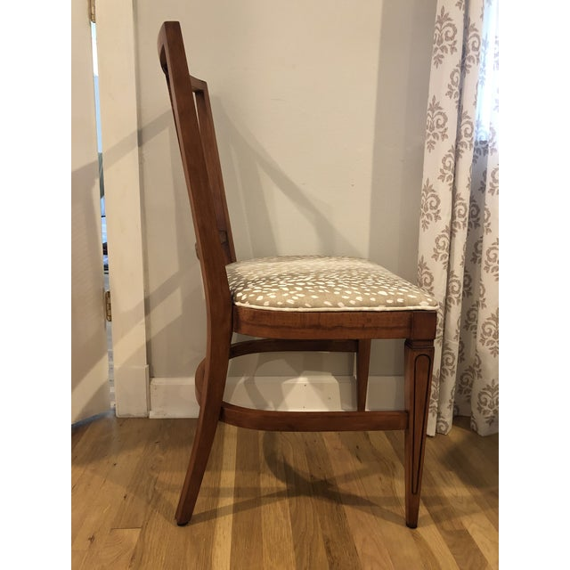 This rock maple side chair was discovered painted with dark brown paint and aqua upholstery. The caned panel caught my...