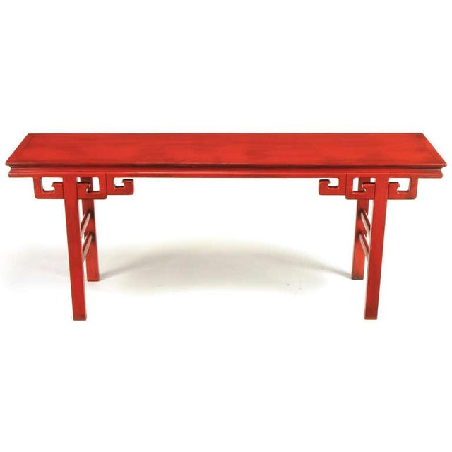 Carved and lacquered Chinoiserie altar table or console in the style of James Mont. Squared dowel legs with double side...