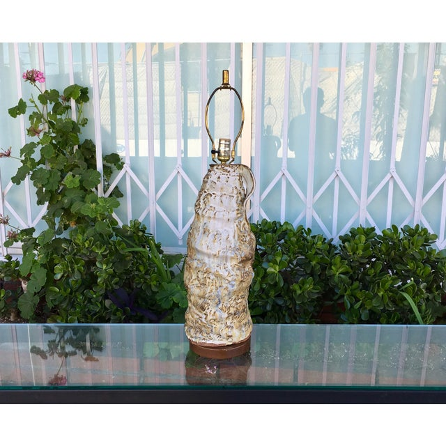 This vintage ceramic glazed lamp is in excellent condition. Its organic structure and neutral finish make it an excellent...