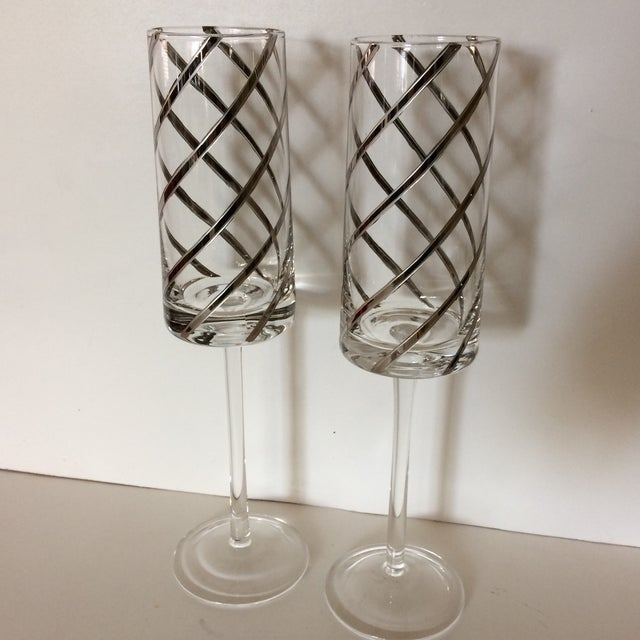 A pair of Very unusual Platinum Swirl Crystal Champagne Toasting Flutes.